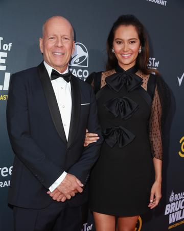 2018:  Bruce Willis (L) and Emma Heming attend the Comedy Central Roast of Bruce Willis at Hollywood Palladium on July 14, 2018 in Los Angeles, California.  (Photo by Rich Fury/Getty Images)