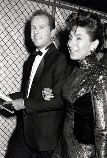 1986: Bruce Willis and Sherry Riveria during 2nd Commitment to Life AIDS Project Benefit at Wiltern Theater in Los Angeles, California, United States. (Photo by Ron Galella/Ron Galella Collection via Getty Images)