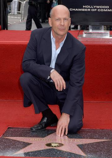 2006: Bruce Willis is honoured at the footprint ceremony outside Mann's Chinese Theatre.(Photo by Gregg DeGuire/WireImage)