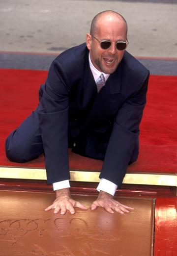 1995: Bruce Willis during Bruce Willis Footprint Ceremony at Mann's Chinese Theatre in Hollywood, California, United States. (Photo by Jim Smeal/Ron Galella Collection via Getty Images)