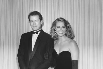 1985: US actor Bruce Willis and US actress Cybill Shepherd, both in formal evening wear, attending the 37th annual Emmy Awards, held at the Pasadena Civic Auditorium, Pasadena, California, USA, 22 September 1985. Both Willis and Shepherd star in television show, 'Moonlighting'. (Photo by Darlene Hammond/Getty Images)