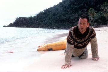 2000: Tom Hanks washed up on the beach of an island in a scene from the film 'Cast Away', 2000. (Photo by 20th Century-Fox/Getty Images)
