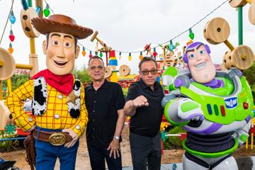 2019: Tom Hanks (2nd-L), Tim Allen (2nd-R) and Buzz Lightyear (in costume) appear with characters from the film inside Toy Story Land at Disneys Hollywood Studios at Walt Disney World Resort on June 8, 2019 in Lake Buena Vista, Florida. (Photo by Matt Stroshane/Disney Resorts via Getty Images)