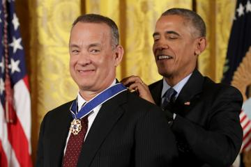 2016:  U.S. President Barack Obama awards the Presidential Medal of Freedom to Academy Award winner, filmmaker and social justice advocate Tom Hanks during a ceremony in the East Room of the White House November 22, 2016 in Washington, DC. Obama presented the medal to 19 living and two posthumous pioneers in science, sports, public service, human rights, politics and the arts.  (Photo by Chip Somodevilla/Getty Images)