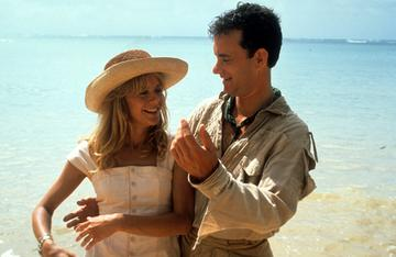 1990: Meg Ryan and Tom Hanks on a beach in a scene from the film 'Joe Versus The Volcano', 1990. (Photo by Warner Brothers/Getty Images)