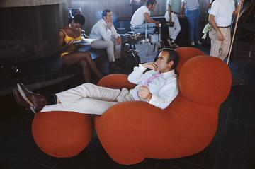 Actress Trina Parks and Scottish actor Sean Connery relax between takes on the set of the James Bond film 'Diamonds Are Forever', USA, 1971. They are on location at the Elrod House in Palm Springs, California, and Connery is sitting in a 1969 Gaetano Pesce 'Up' chair. (Photo by Anwar Hussein/Getty Images)