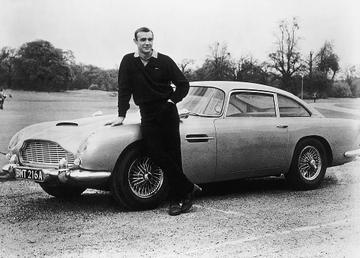 Actor Sean Connery, the original James Bond, is pictured here on the set of Goldfinger with one of the fictional spy's cars, a 1964 Aston Martin DB5.  (Photo by Getty Images)