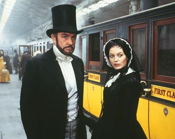 """British actors Lesley Anne Down (R) and Sean Connery on the set of 1978 film """"The First Great Train Robbery"""" (La Grande Attaque du Train d'Or), directed by Michael Crichton. (Photo by Sunset Boulevard/Corbis via Getty Images)"""