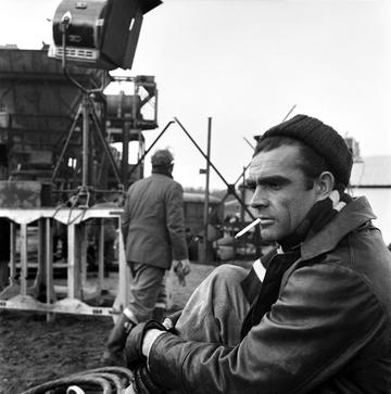 """Sean Connery on the set of the film """"Action of the Tiger"""". November 1956 A357-001 (Photo by WATFORD/Mirrorpix/Mirrorpix via Getty Images)"""