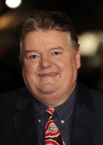 Robbie Coltrane took on the role of half-giant Rebeus Hagrid. Coltrane had previously starred as Valentin Dmitrovich Zhukovsky in various James Bond films. He has since gone on to star alongside his Harry Potter co-stars Julie Walters and Emma Thompson in Disney's 'Brave' (2012). Most recently, he has starred in Channel 4's 'National Treasure' (2016).   (Photo by Eamonn McCormack/WireImage)