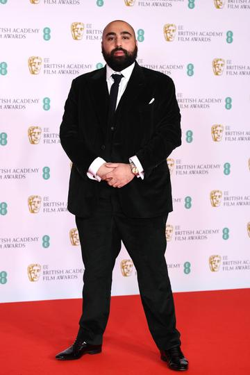 Awards Presenter Asim Chaudhry attends the EE British Academy Film Awards 2021 at the Royal Albert Hall on April 11, 2021 in London, England. (Photo by Jeff Spicer/Getty Images)