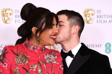 Awards Presenter Priyanka Chopra Jonas with her husband Nick Jonas attend the EE British Academy Film Awards 2021 at the Royal Albert Hall on April 11, 2021 in London, England. (Photo by Jeff Spicer/Getty Images)
