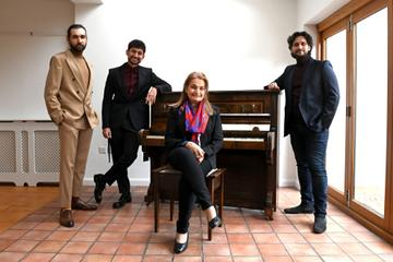 Actor Amir El Masry (2L) poses in his award show look for the EE British Academy Film Awards 2021 with his mother Hoda El Masry and brothers Ehab El Masry and Mel El Masry on April 11, 2021 in London, England. Due to COVID-19 restrictions nominees will be attending virtually alongside a virtual audience.  (Photo by Kate Green/Getty Images for ABA )