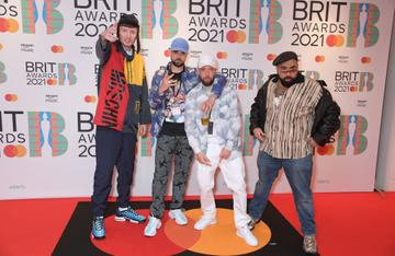 (L-R) Steve Stamp, Allan Mustafa aka MC Grindah, Hugo Chegwin and The Narcicyst arrive at The BRIT Awards 2021 at The O2 Arena on May 11, 2021 in London, England.  (Photo by David M. Benett/Dave Benett/Getty Images)