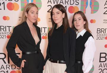 (L-R) Alana Haim, Danielle Haim and Este Haim of HAIM arrive at The BRIT Awards 2021 at The O2 Arena on May 11, 2021 in London, England.  (Photo by David M. Benett/Dave Benett/Getty Images)