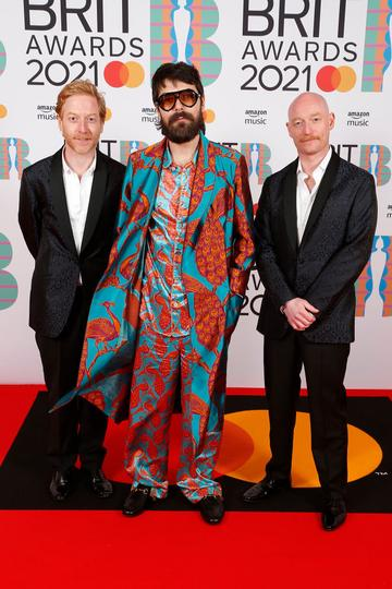 James Johnston, Simon Neil and  Ben Johnston of Biffy Clyro attend The BRIT Awards 2021 at The O2 Arena on May 11, 2021 in London, England. (Photo by JMEnternational/JMEnternational for BRIT Awards/Getty Images)