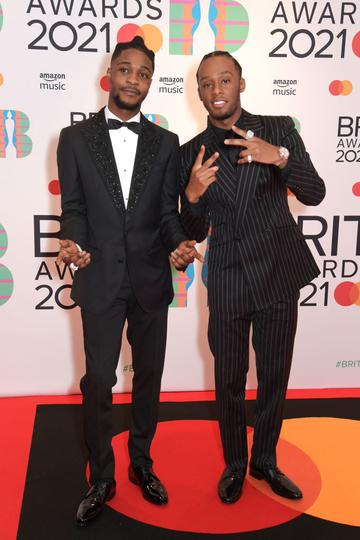Young T and Bugsey arrive at The BRIT Awards 2021 at The O2 Arena on May 11, 2021 in London, England.  (Photo by David M. Benett/Dave Benett/Getty Images)