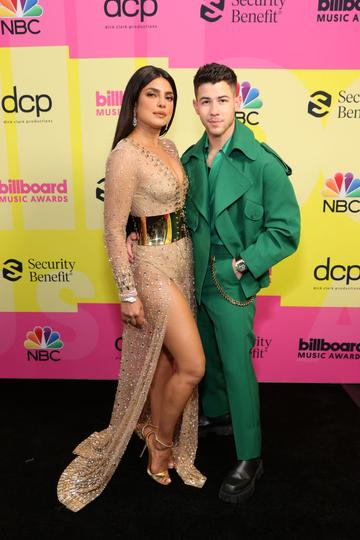 (L-R) Priyanka Chopra Jonas and Nick Jonas pose backstage for the 2021 Billboard Music Awards, broadcast on May 23, 2021 at Microsoft Theater in Los Angeles, California. (Photo by Rich Fury/Getty Images for dcp)
