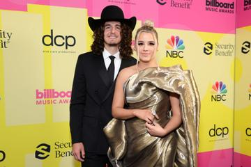 (L-R) Cade Foehner and Gabby Barrett pose backstage for the 2021 Billboard Music Awards, broadcast on May 23, 2021 at Microsoft Theater in Los Angeles, California. (Photo by Rich Fury/Getty Images for dcp)