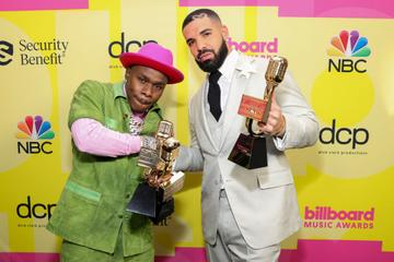 (L-R) DaBaby, winner of the Top Rap Song Award for 'Rockstar' and Drake, winner of the Artist of the Decade Award, pose backstage for the 2021 Billboard Music Awards, broadcast on May 23, 2021 at Microsoft Theater in Los Angeles, California. (Photo by Rich Fury/Getty Images for dcp)