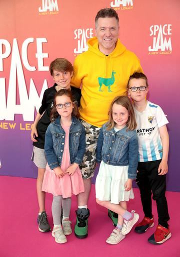 Radio Presenter Dave Moore with children at the Irish Premiere screening of Space Jam : A New Legacy at the Odeon Cinema in Point Square,Dublin Picture PIP