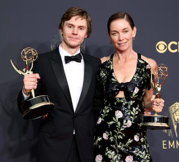 LOS ANGELES, CALIFORNIA - SEPTEMBER 19: (L-R) Evan Peters, winner of the Outstanding Supporting Actor In A Limited Or Anthology Series Or Movie award for 'Mare Of Easttown' and Julianne Nicholson, winner of the Outstanding Supporting Actress In A Limited Or Anthology Series Or Movie award for 'Mare Of Easttown,' pose in the press room during the 73rd Primetime Emmy Awards at L.A. LIVE on September 19, 2021 in Los Angeles, California. (Photo by Rich Fury/Getty Images)
