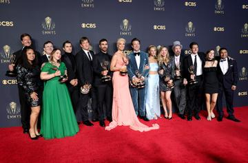 LOS ANGELES, CALIFORNIA - SEPTEMBER 19: (L-R) Leann Bowen, Jeff Ingold , Tina Pawlik, Jeremy Swift, Phil Dunster , Bill Lawrence, Brett Goldstein, Hannah Waddingham, Jason Sudeikis, Juno Temple, Brendan Hunt, Bill Wrubel, Phoebe Walsh, and Nick Mohammed, winners of the Outstanding Comedy Series award for 'Ted Lasso,' pose in the press room during the 73rd Primetime Emmy Awards at L.A. LIVE on September 19, 2021 in Los Angeles, California. (Photo by Rich Fury/Getty Images)