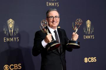 LOS ANGELES, CALIFORNIA - SEPTEMBER 19: John Oliver, winner of the Outstanding Variety Talk Series and Outstanding Writing for a Variety Series awards for 'Last Week Tonight with John Oliver,' poses in the press room during the 73rd Primetime Emmy Awards at L.A. LIVE on September 19, 2021 in Los Angeles, California. (Photo by Rich Fury/Getty Images)